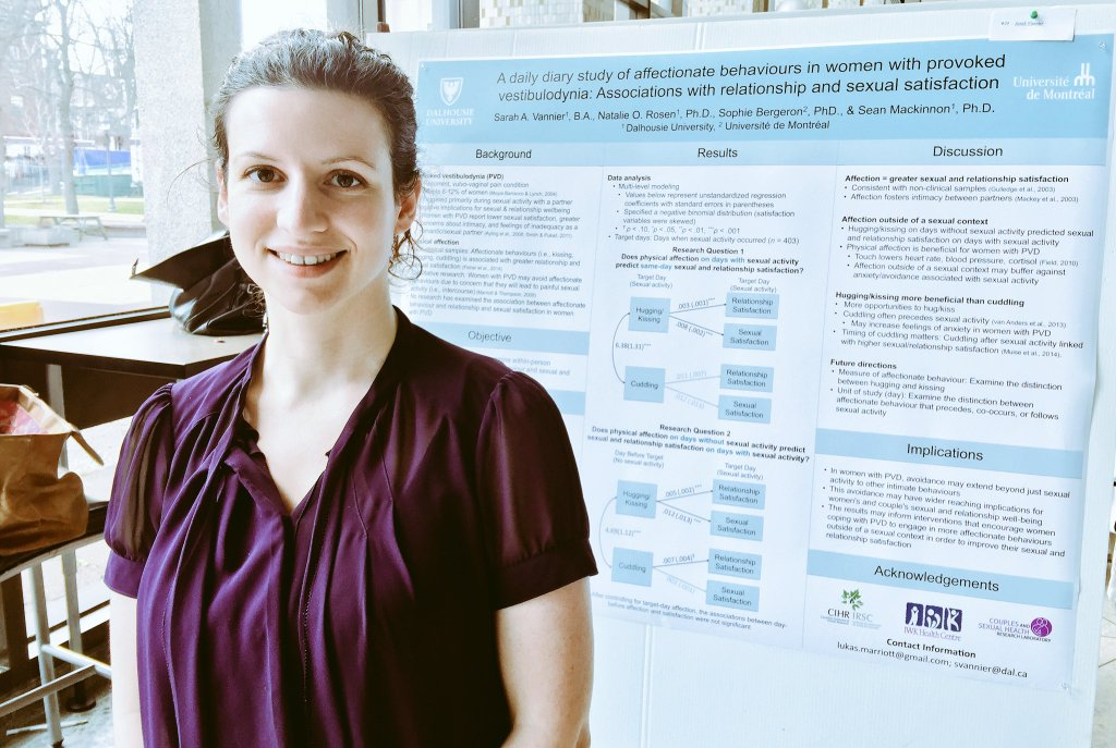 Sarah Vannier, smiling, standing in front of her award-winning research poster at Dalhousie's Pain Day Conference
