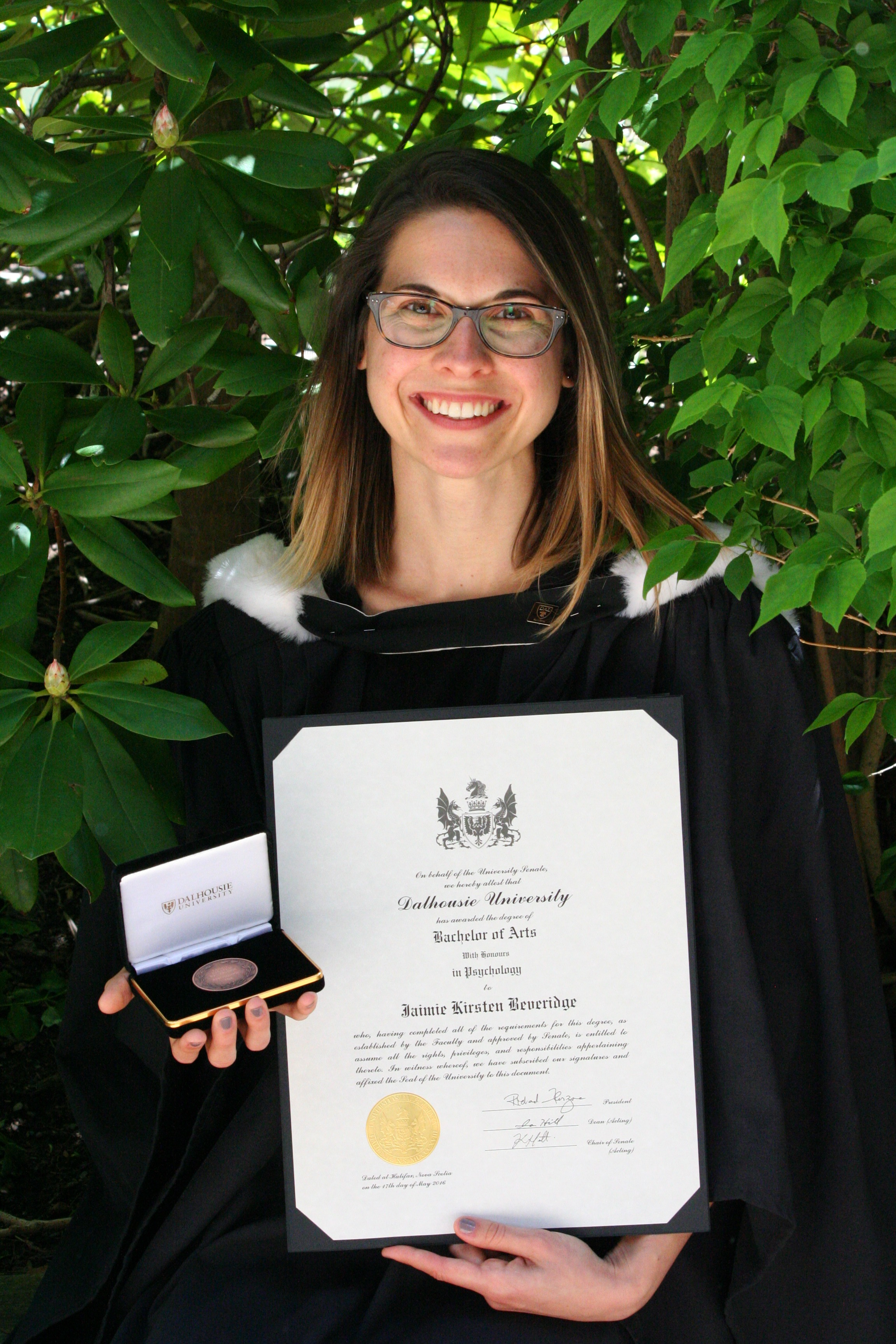 Jaimie Beveridge with her University Medal in Psychology