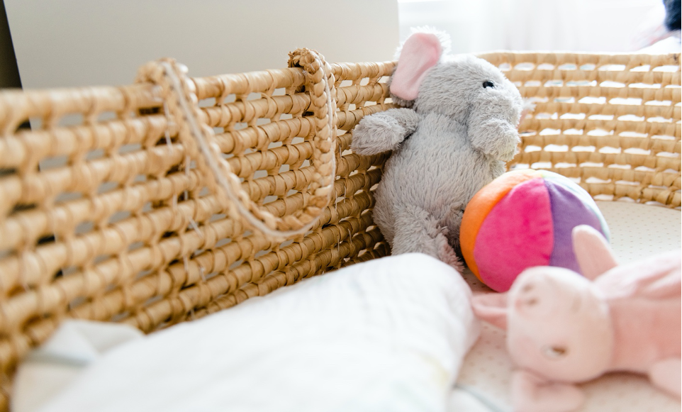 baby toys in a bassinet